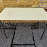 Yellow_formica_table_with_metal_legs.jpg